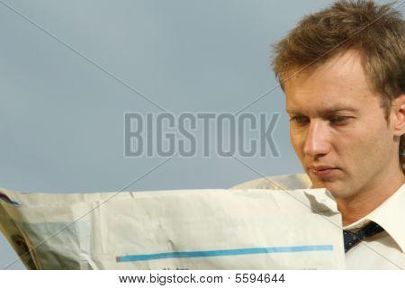 Man Reading A Blank Newspaper