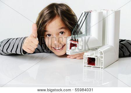 Kid holding plastic pvc window profile