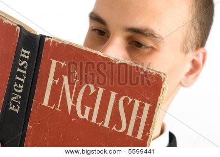 A Man Reading an English Book