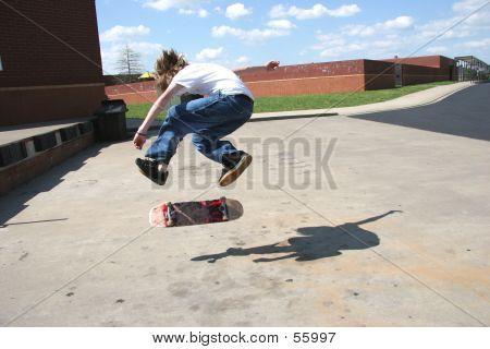 Brave Skateboarder Doing 360 Flip