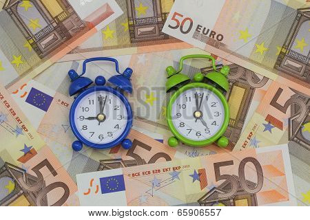 Miniature clocks showing nine and five o'clock on banknotes, concept of a nine to five job