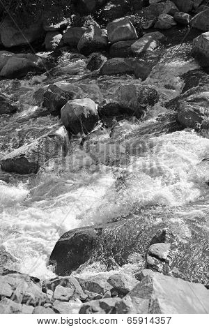 Monochrome image of the spectacular, turbulent  and dangerous rapids of the Kern River, which flows out of the Southern Sierra Nevada Range in California. poster