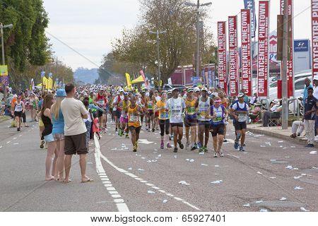 Spectators Watching Passing Runners In Comrades Marathon