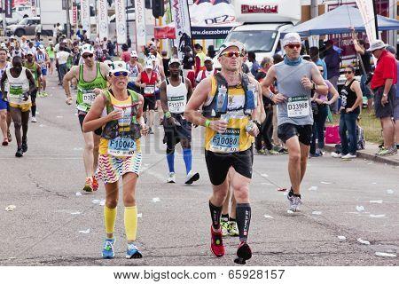 Colorful Runners Participate In Comrades Marathon