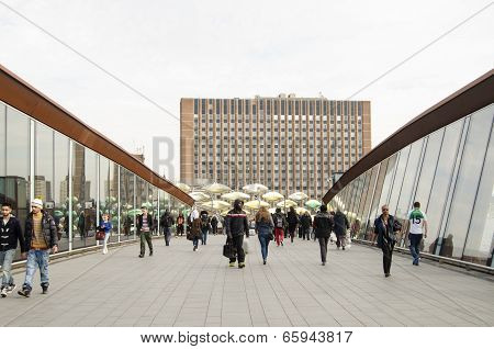 Pedestrians on footbridge, Stratford, London
