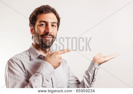 Young man give the thumbs up and make gesture with hand
