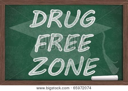 Drug Free Zone Message Drug Free Zone written on a chalkboard with chalk and a grad cap poster