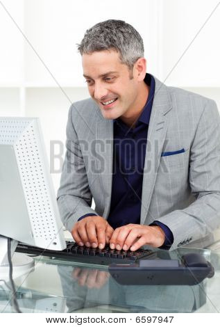 Positive Businessman Working At A Computer