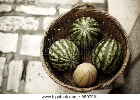 watermelons and melon in a basket