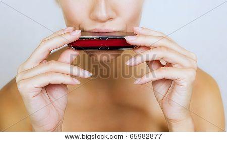Girl Play Blues Harmonica, Close-up