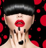 High Fashion Model Girl Portrait with Trendy Hair style, Make up and Manicure. Long Black Fringe Hairstyle, Black Matte Nail Polish and Red Matte Lipstick. Woman Makeup. Sexy Lips. Haircut poster