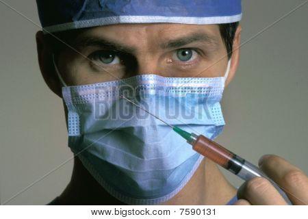 Male Surgeon Holding Syringe