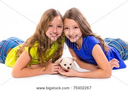 happy twin sister kid girls and puppy dog lying playing on white background poster