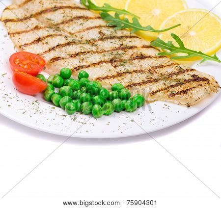 A close-up view of a grilled salmon steak served with peas and tomatoes poster