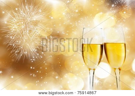 Glasses with champagne against fireworks and sparkling holiday background