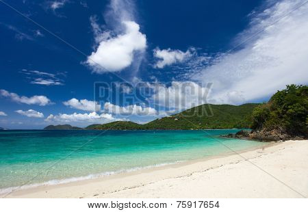 Beautiful tropical beach with white sand, turquoise ocean water and blue sky at St John, US Virgin Islands in Caribbean poster