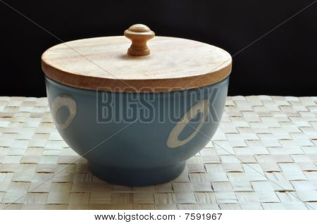 Blue bowl with wooden cover