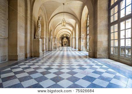 Versailles, France - JUN 20: Interior of main corridor at Chateau de Versailles (Palace of Versailles) on June 20, 2014, France. Versailles palace is in UNESCO World Heritage Site list since 1979.
