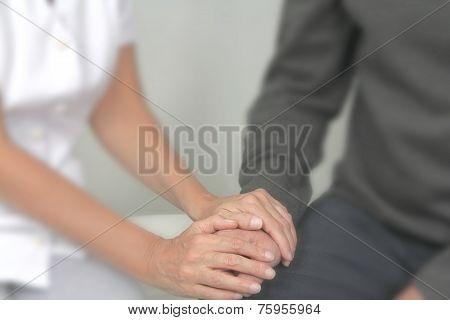 Therapist offering comfort to patient