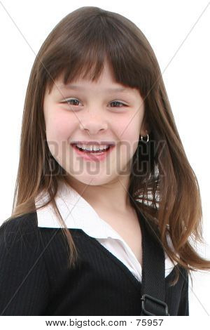 Seven Year Old Girl With Big Smile Over White