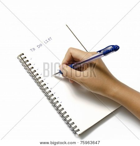 Woman Hand Writing With Pen On Notebook