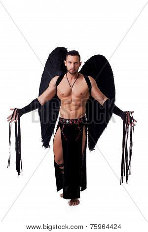 Male stripteaser dressed in suit of fallen angel