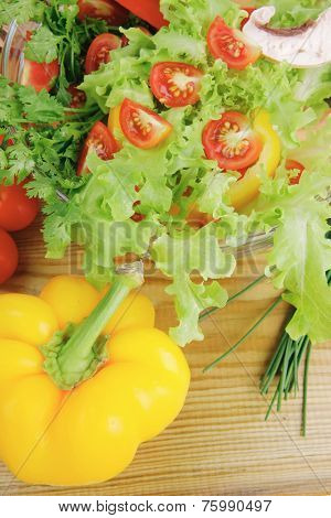 fresh salad and cherry's on wooden table