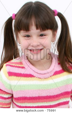 Seven Year Old Girl With Big Smile In Pink Sweater