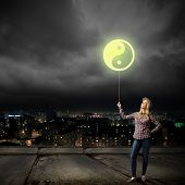 Young girl in casual and yin yang sign poster