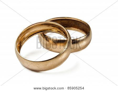 The Isolated Wedding Rings On A White Background.