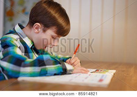 Little Shoolboy Make Mistake In Workbook