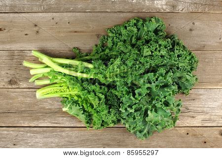 Bunch of kale over a wooden background