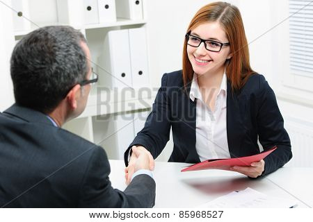 Job applicant having interview. Handshake while job interviewing poster