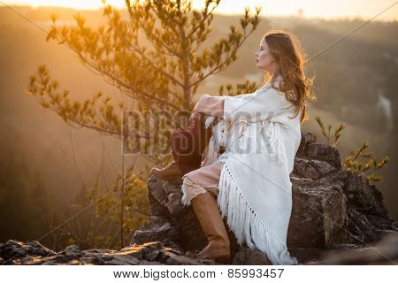 Dreamer woman meeting sunrise at the mountains