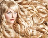 Beauty Blonde Woman Portrait. Beautiful model girl with long curly blond hair. Hairdressing, hairstyle. Healthy Long Wavy Hair. White Hair. Sexy Model. Perfect Skin and Make up. Hair Extensions  poster