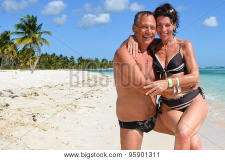 Couple In Love On The Carribean Sea And White Sand