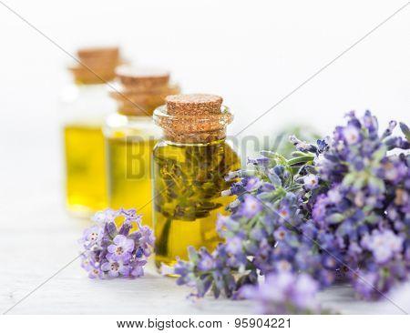 Essentials oils with lavender flowers. Wellness still-life.