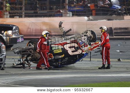 Daytona, FL - Jul 06, 2015:  The remains of the car of Austin Dillon (3) sit in the grass after wrecking on the final lap of the Coke Zero 400 at Daytona International Speedway in Daytona, FL.