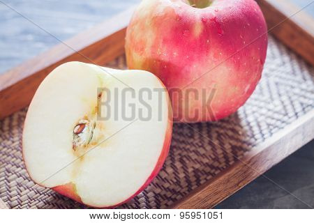 Red Apple On Wooden Tray