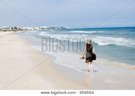 Woman Walking At The Sea Beach