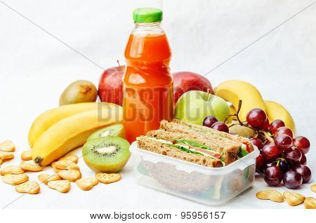 School Lunch With A Sandwich, Fresh Fruits, Crackers And Juice