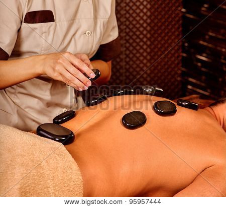 Man  having oil Ayurveda spa treatment. Body part and close up. poster