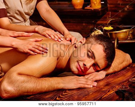 Happy man  having oil Ayurveda spa treatment.