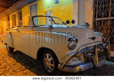 American classic convertible in the cobble street of Trinidad, Cuba