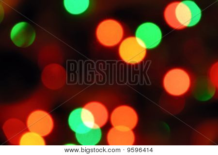 Color photo of blurred Christmas lights at night poster
