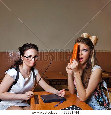 Teacher Scolds A Pupil For Failure Of Homework.