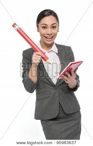Happy Girl In Grey Suit With Giant Pencil And Pad Of Paper.