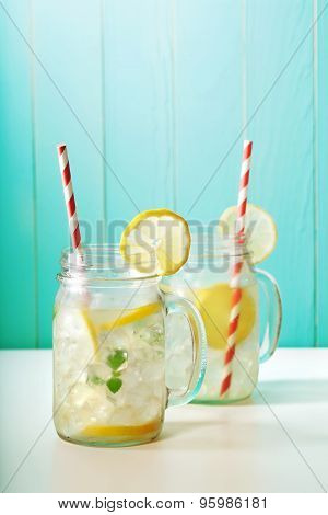 Homemade lemonade in mason jars with big red striped straws poster