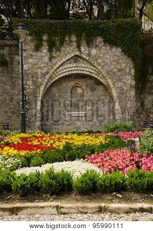 flower garden with stone wall in Lillafured