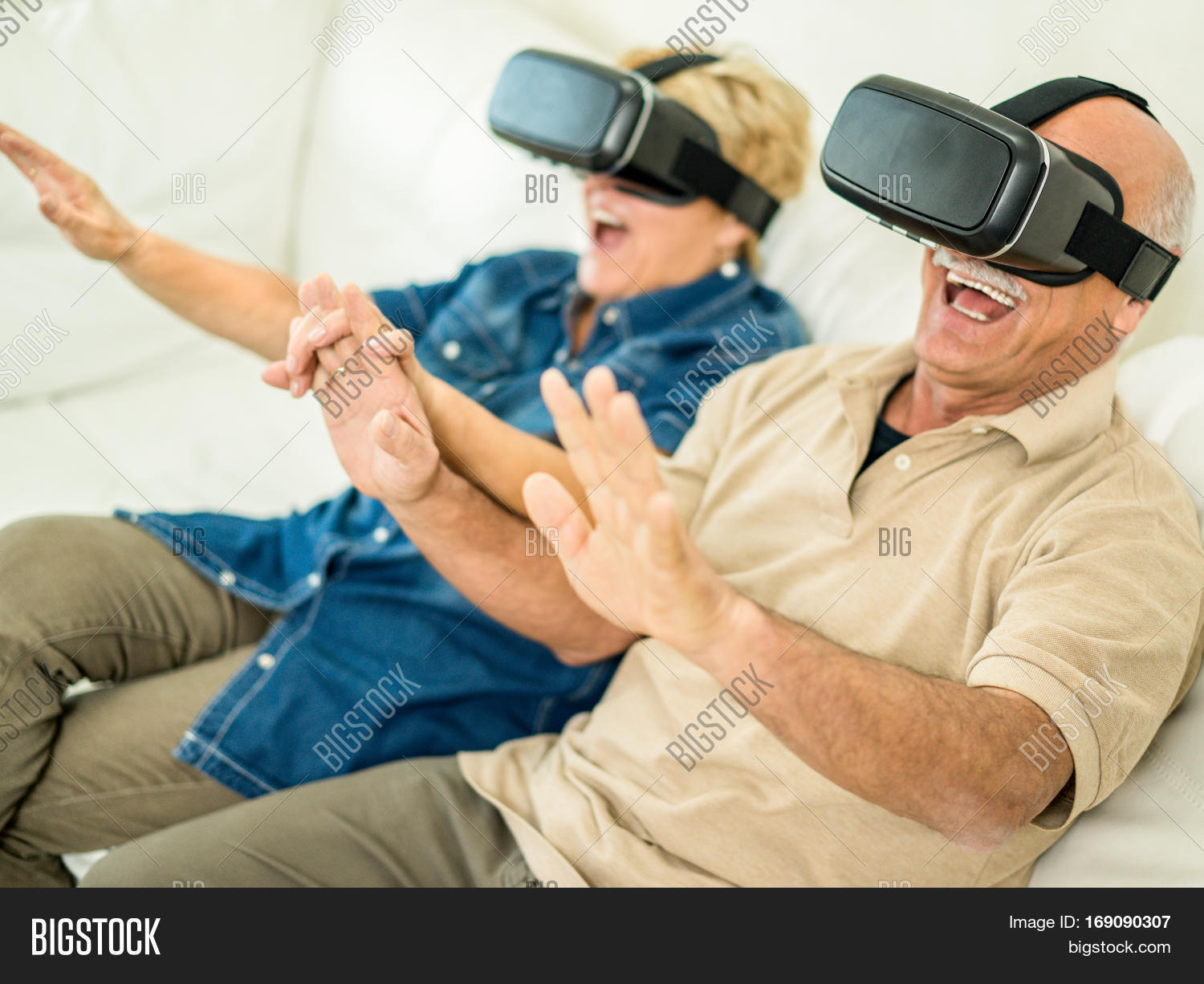 c5b3863d61d Senior mature couple having fun with virtual reality glasses - Old people  using new vr headset